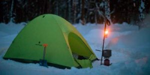 Backpacking tent pitched in snow