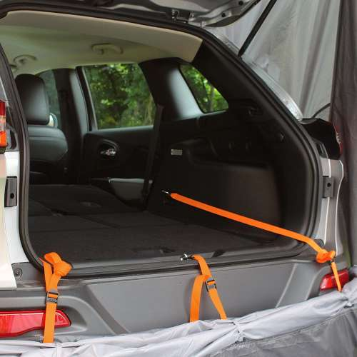 suv tent strapped into cargo area of suv