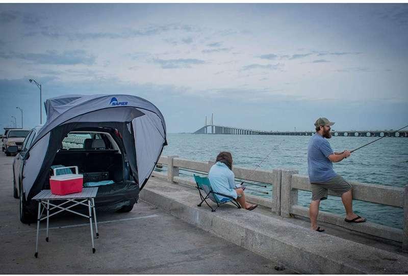 2 men fishing beside napier cove tent