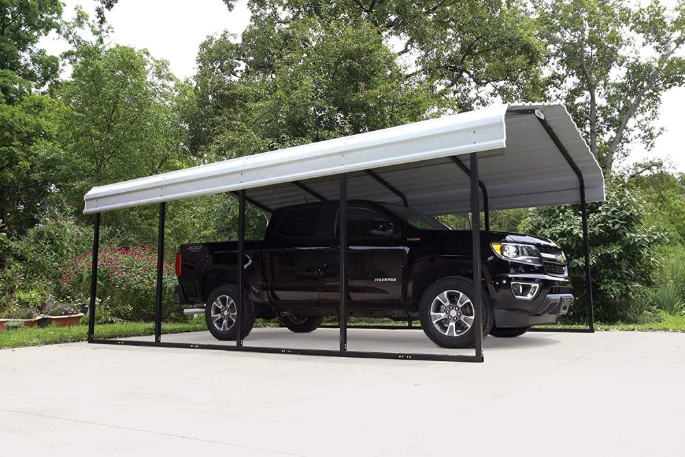 a black pickup truck under an Arrow steel carport