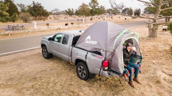 Napier Backroadz Truck Tent relaxing on bed