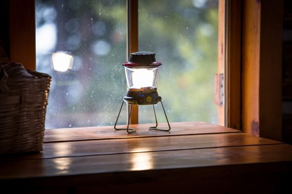 an LED camping lantern on a table