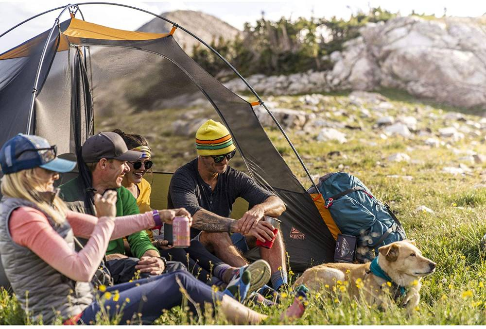 a group of campers sitting in the grand mesa tent