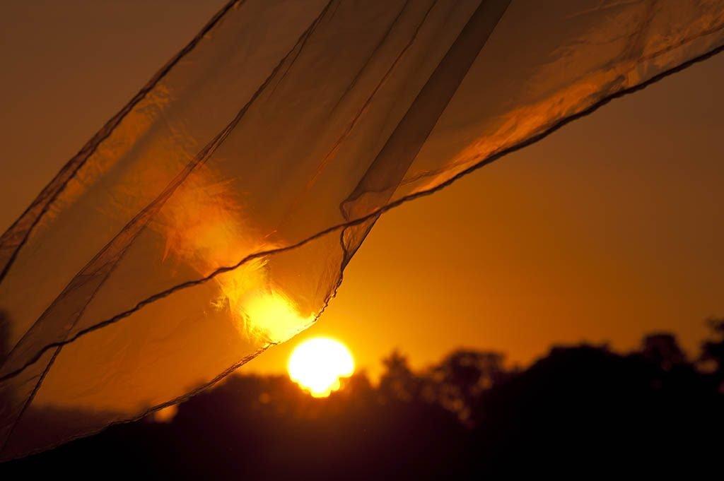 the bright sun shining through a tent
