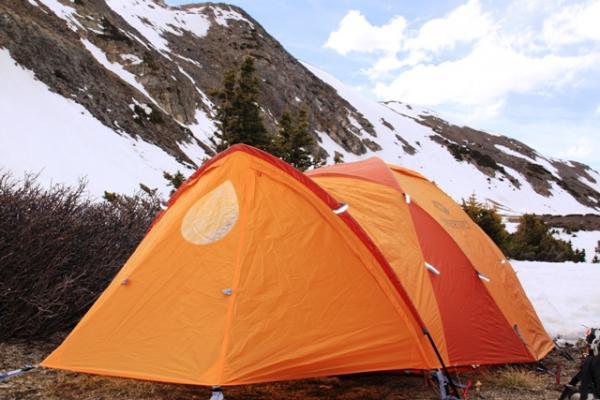 marmot thor tent beside a snowy mountain