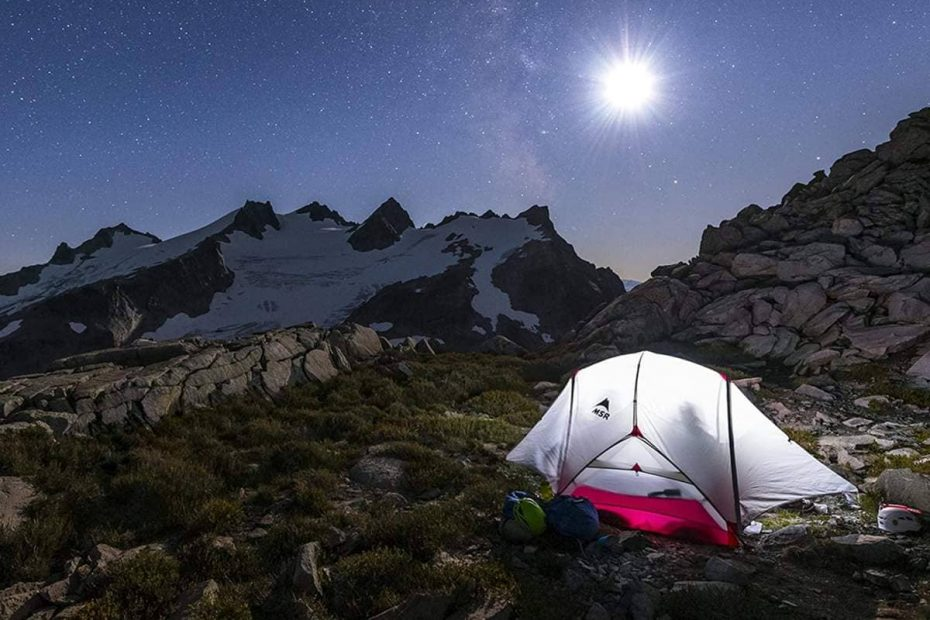 A pitched MSR tent at night under a beautiful moon