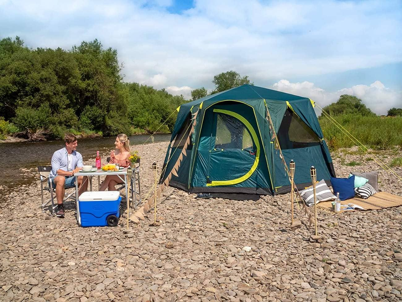 the Coleman Blackout Octagon tent pitched by a river